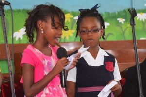 Rashauna singing her mother Maxine Lashley's favourite gospel song with her schoolmate Hannah.