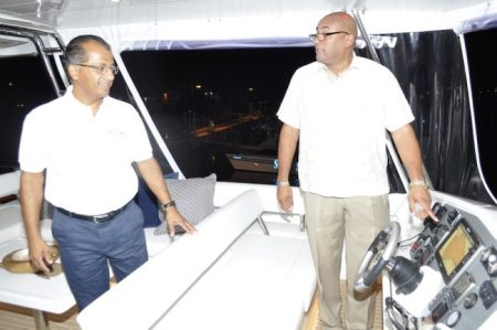 Businessman Peter Harris (left) and Minister of Tourism Richard Sealy onboard The Tide Dancer.