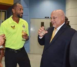 Head cricket coach Floyd Reifer chatting with Sagicor GM, Edward Clarke.