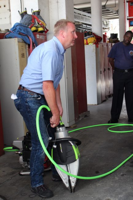 Dave Stone from Angloco Limited demonstrating how to use one of the new Jaws of Life handed over to the Barbados Fire Service.