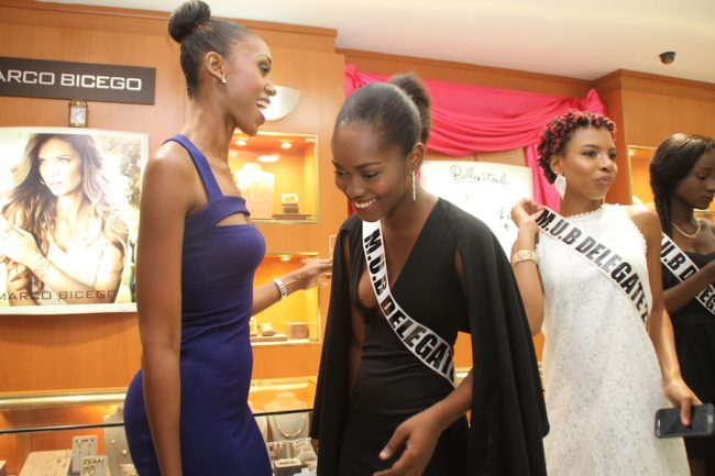 The last Miss Universe to be crowned Jewel Garner (left) sharing a light moment with one of the 2016 Miss Universe Barbados delegates.