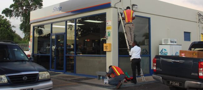 Employees of SmartTech International installing security cameras at the Sol Service Station in Jackmans, St Michael.
