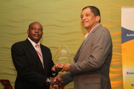 Managing Director fo Sentry Insurance Brokers Ltd Stephen Ollivierre with his sectoral award for general business.