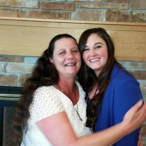 In this July 28, 2016 photo provided by Lanni Klasner, Rita Maze, left, and her daughter, Rochelle Maze, pose for a photo in Great Falls, Montana.