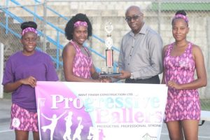 Interim chief executive officer of the National Sports Council, Jerry Blenman, gives Progressive Ballers the trophy for having the best banner on parade. (Pictures by Morissa Lindsay)