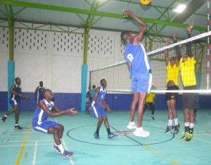 Progressive's captain Akeem Payne (No. 8, in blue) goes hard past the Foundation defence. (Pictures by Morissa Lindsay)
