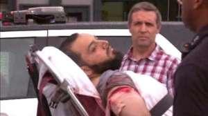 US terror blasts suspect Ahmad Khan Rahami (on stretcher) in custody.