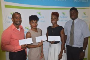 (From left) Marlon Dottin, Melissa Burrowes and Lynette Thompson were presented with sponsorship support by Roger Spencer (right) of Sagicor General Insurance.