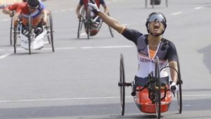 Andrea Eskau storms to victory in the hand cycling road race.