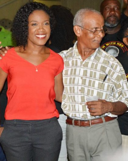 BLP St Michael South Central candidate Marsha Caddle hugs her dad, Russell Caddle, as the vote count makes it clear that she is the winner.
