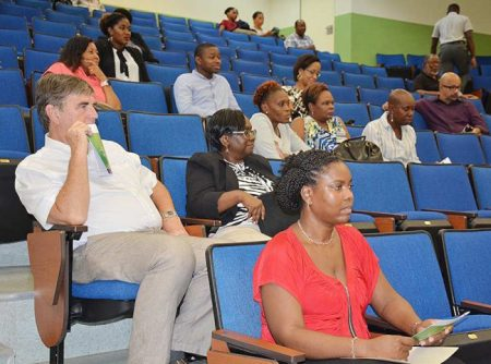 UWI and medical professionals at the lecture.