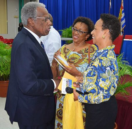 From left, UWI Chancellor Sir George Alleyne greets Professor Vivienne Roberts, and UWI Cave Hill Principal, Eudine Barriteau.