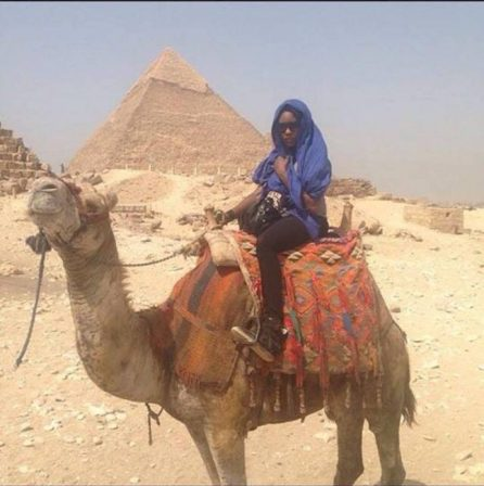 Taking a ride on a camel by the Pyramids at Giza in Egypt.