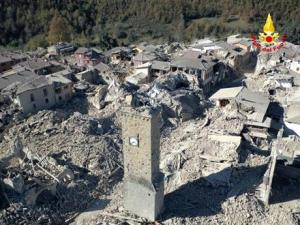 An aerial view of the destroyed hilltop town of Amatrice as an earthquake with a preliminary magnitude of 6.6 struck central Italy, Sunday.