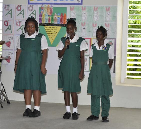 Danesha Forde, Zoe Beckles and Kiara King reciting a poem.