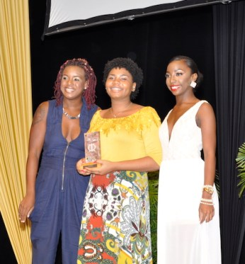 Reyda Gay accepting her award for Best Script for Beneath The Dock from Shakirah Bourne and Tiffani Lynch.