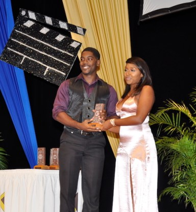Best Supporting Actor Marcus Myers accepting his award from Satya Collymore.