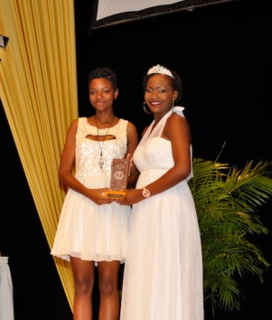 Best Supporting Actress Karissa Hoyte accepting her award from calypso queen Aziza.