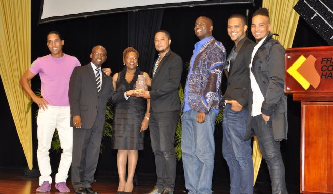 The cast of Once Upon A Time in Ichirouganiam accepting their award for Best Feature Film from Minister Stephen Lashey (second left) and Lynette Eastmond (third left).