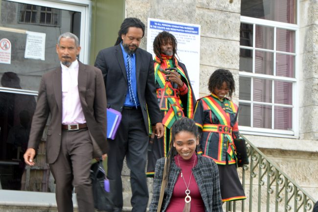 Attorneys Andrew Pilgrim, QC, (left) Ajamu Boardi (second from left), and Sian Lange (foreground) leaving the courthouse with their Rastafarian clients.