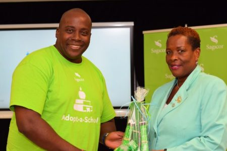 Adopt-A-School volunteer Wayne Edwards with Principal of Hillaby Turner's  Hall Primary School Angela Edwards.