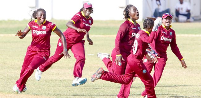 Erva Giddings (second left) celebrating with her team-mates today after West Indies defeated England.