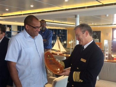 Minister of Tourism and International Transport Richard Sealy gifts Rune Lokling, captain of MV Viking Start, with a plaque to mark his inaugural visit to Barbados.