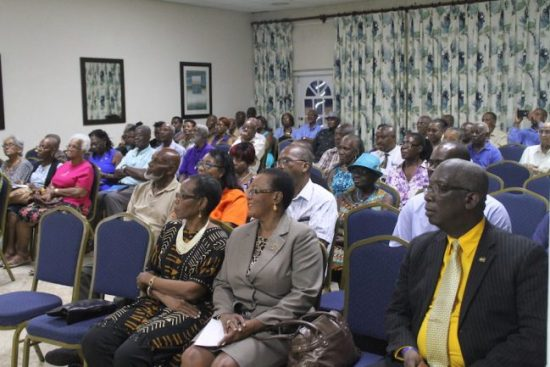 Members of the audience at last night's meeting which included Minister of Education Ronald Jones and Minister of Foreign Affairs and Foreign Trade Maxine McClean, as well as other members of the ruling party.