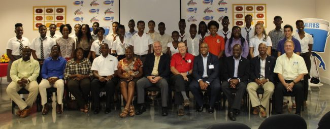 Organizers of the Classroom to Boardroom programme pose  with the students and officials of Harris Paints Barbados.