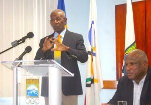 Chairman of the 50th Anniversary Independence Barbados Olympic Association Games Committee, Trevor Browne (left), making a point while the BOA's  Glyne Clarke listens attentively.
