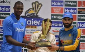 West Indies captain Jason Holder (l) and Pakistan skipper Misbah-ul-Haq pose with the trophy for which will compete in the Test series.