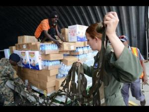 Relief supplies destined for Haiti are sorted by Jamaica Defence Force (JDF) and US soldiers today at the JDF hanger, at the Norman Manley International Airport in Kingston.