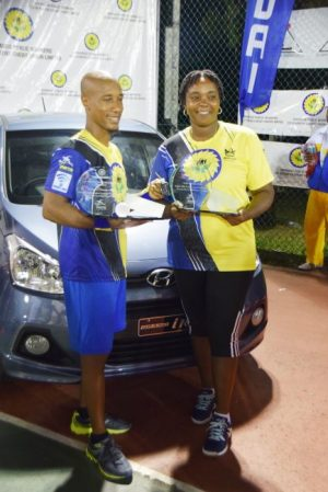 Tennis monarchs Mark Griffith and Kim Holder pose with their trophies and the king's new Hyundai.