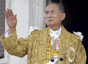 Thailand King Bhumibol Adulyadej acknowledges the crowd in Bangkok during the celebrations of the 60th anniversary of his accession to the throne on June 9, 2006.