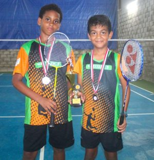 (From left) Harrison Griffith was third in the under-13 singles and second in the doubles with his partner Joshua Valere who competed in the under-11 singles and was victorious.