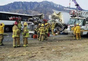 The scene of crash between a tour bus and a semi-truck crashed on Interstate 10 near Desert Hot Springs, near Palm Springs, in California's Mojave Desert on Sunday.