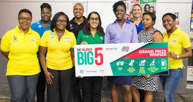 The RUBIS Big 5 Promotion team celebrates with winner Johan Holder (third from right) at the RUBIS Wildey Service Station.
