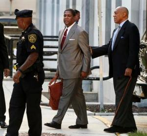Bill Cosby, right, arrives for a hearing in his sexual assault case at the Montgomery County Courthouse on Tuesday.
