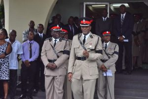 Acting Commisioner of Police Oral Williams (left) and Acting Assistant Commisioner of Police Irving Boyce (to his right) leading other officers at the funeral service of the late Sergeant Elvis Grafton Foster.