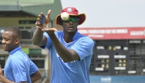 Captain Jason Holder and Miguel Cummins at a practice session Tuesday.