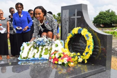 President of the Young Women's Christian Association Tamita Griffith layinga wreath.