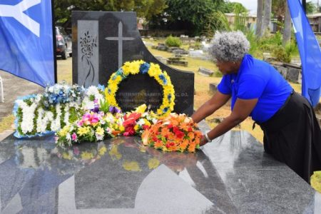 President of the Caribbean Women's Association Marilyn Rice-Bowen laying a wreath.