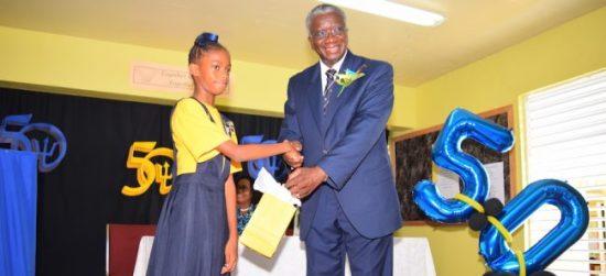 School's head girl Janae Jordan-White presented Prime Minister Stuart with a token of appreciation.