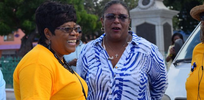 Opposition Leader Mia Mottley (right) in discussion with Chief Education Officer Karen Best, who was one of the organizers of today's event.
