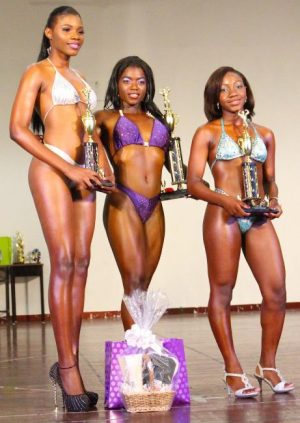 Elsie Medford (centre) of the Barbados Community College did well to retain her Miss Schoolgirl Body Fitness title ahead of Adrianna Yarde of Lester Vaughan (right) and Rosan Belgrave of Grantley Adams.