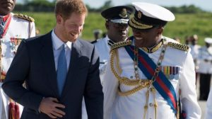 Prince Harry shares a joke with Governor General Sir Rodney. Williams.