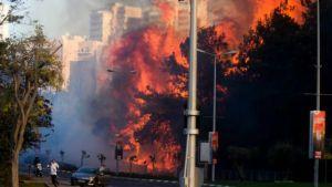 Huge flames roared between apartment blocks as residents fled.