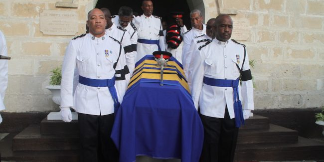 The body of the late Mervyn Holder being carried from the church to the gravesite by his former colleagues in the RBPF.