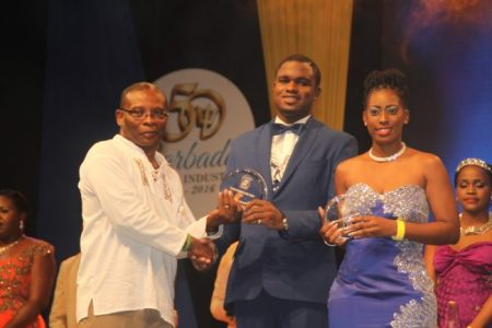 Most Outstanding Parish Ambassadors Cadesha Rouse and Brandon Beckles receiving their prizes from Acting Minister of Culture Sports and Youth Denis Kellman.