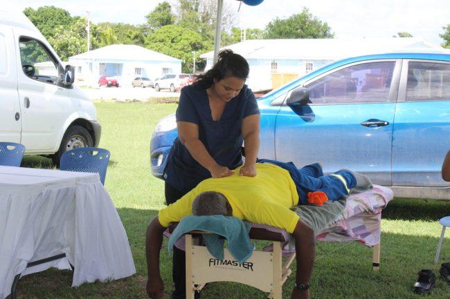 Massage Therapist Kristen Rojas giving one of the BNOC Ltd workers a massage.
